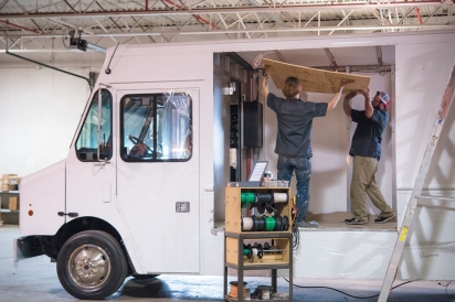 putting finishing touches on food truck