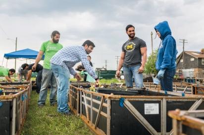 group planting at HUDA gardens