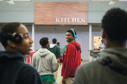 student going into school cafeteria