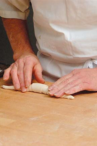 rolling out homemade croissants