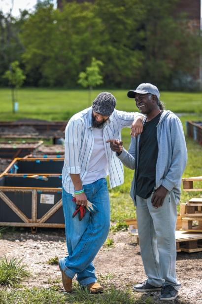two men planting at HUDA gardens